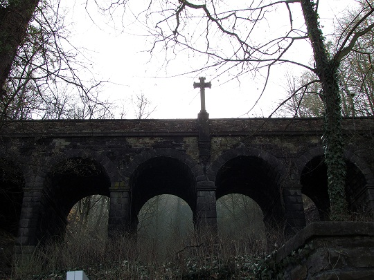 Haunting photo of cross on bridge